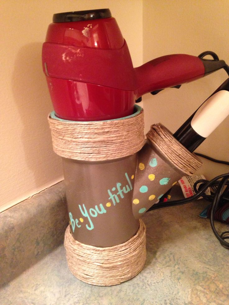 Blow dryer and curling iron holder made out of a PVC pipe! Spray painted that decorated with twine and writing! Love how it turned out.