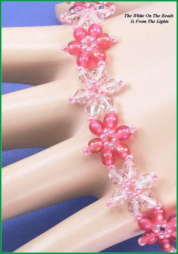 """Jewelry is made with small beads. Some are glass or stone. Adult supervision is recommended. This bracelet is made with Miyuki 11/0 carnation pink glass seed beads along with 4mm light pink Chinese crystal bicone glass beads and, is accented with 4mm Czech fuchsia luster iris druk glass beads and hooks with a toggle clasp. Measures approx. 7 1/2"""" long (including clasp) by 5/8"""" wide and is a design pattern from: Deborah Roberti. Priced at only $24.00 with """"FREE SHIPPING"""""""