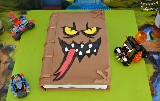 What a cool Book of Monsters birthday cake at this Lego Knights Party Birthday Party! See more party ideas and share yours at CatchMyParty.com
