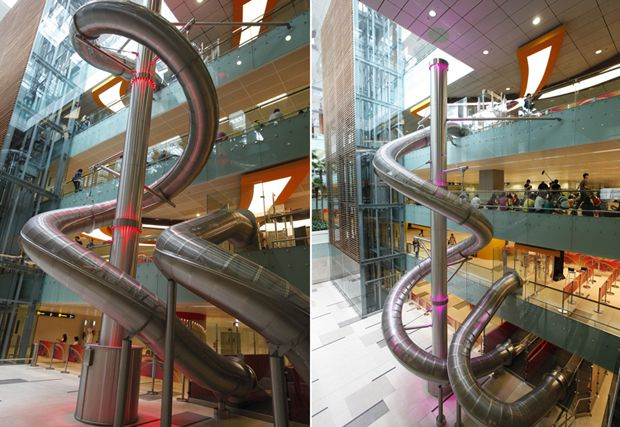 slides for adults in Singapore's Changi Airport. Fun and gets you around faster