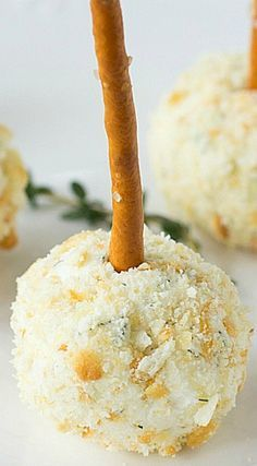 Mini Cheddar Ranch Cheese Ball Bites ~ These cute little bite size cheese ball bites are individually portioned... Included edible pretzel sticks instead of toothpicks so everyone can grab and go.