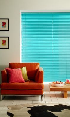 A cool aqua venetian blind brings just a touch of the tropics to this living room scheme