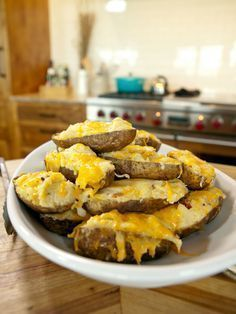 The Pioneer Woman's Twice-Baked Potatoes : Treat yourself to Ree Drummond's twice-baked potatoes that are loaded with cheese, green onions, sour cream and crispy, fried bacon bits.