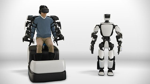 "Toyota Debuts Humanoid Robot Controlled By HTC Vive - VRScout  ||  Share TweetWearable controls and a ""Master Maneuvering System"" lets you pilot the T-HR3 remotely. It seems like you can't swing a stick nowadays without hitting a VR-controlled robot. Jokes aside, we've seen a surprising amount of VR-based robotics over the past couple of months. Whether it be training robots to complete mundane tasks, defuse bombs, ……"