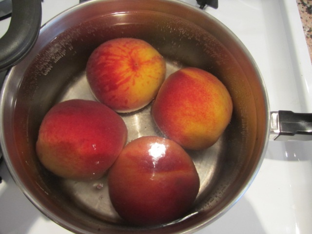 A trick to disrobe your peach.. place in boiling water for 20 seconds and voila! skin should peel right off.