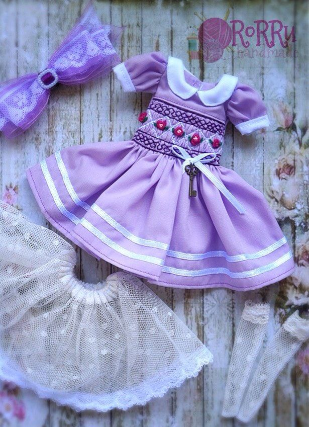 A personal favorite from my Etsy shop https://www.etsy.com/listing/495051610/purple-smocked-pastel-dress