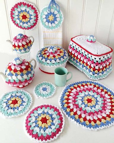 Granny-Go-Round Kitchen Set Crochet Pattern - The NEW Granny-Go-Round Kitchen Set Crochet Pattern is an Easy Skill design that is sure to brighten up your kitchen. This set includes patterns for a Place Mat, Potholder, Hot Mat, Casserole Cover, Toaster Cover, Large Tea Cozy, Small Tea Cozy, Towel Holder, Wash Cloth, and Coaster! We recommend using Premier® Yarns Home Cotton™ when crocheting this adorable set. Available only from Maggie's Crochet