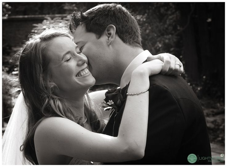 Bride and groom hugging at a wedding at Sidney Sussex College cambridge