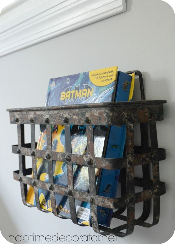 hang a rustic metal basket to hold books in a boys room