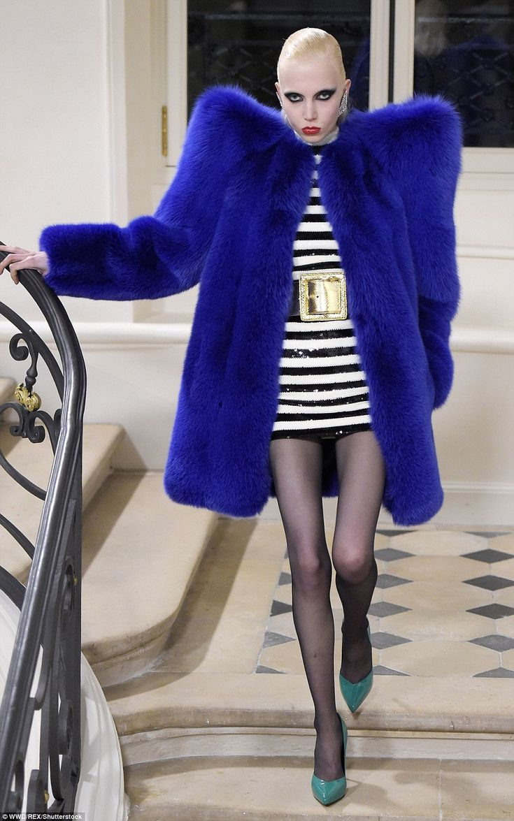 Excess ruled the catwalk at the Yves Saint Laurent show with peroxide-haired models wearin...