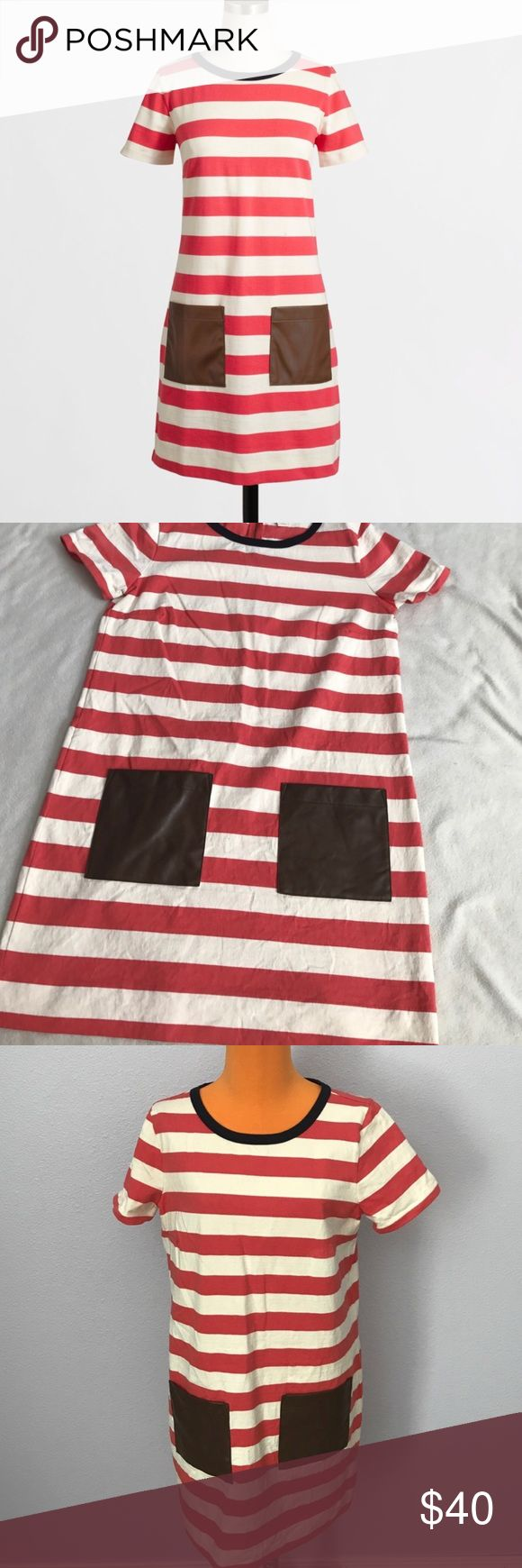 """J Crew Pink Stripe Faux Leather Pocket Dress 34"""" length 19.5"""" armpit to armpit. Stripe with a melon pink color. Faux leather pocket detailing. Navy blue color around collar. Excellent condition. T shirt style dress. Small zipper on back middle. Bundle 2+ items for a discount J. Crew Dresses Midi"""