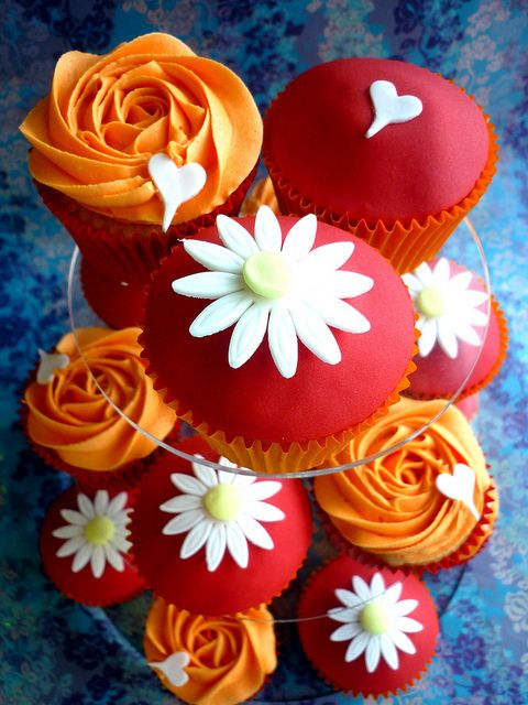 Orange and red cupcake tower by Star Bakery (Liana), via Flickr