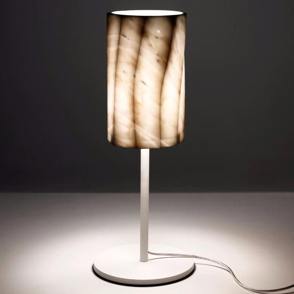 The luxurious and modern Fiamma table lamp is made in Italy by Marmi Serafini. The multifaceted shade is made from solid white Calacatta marble atop a sleek white base.