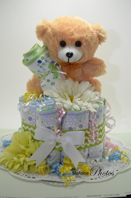 Small diaper cake, perfect gift for baby shower.