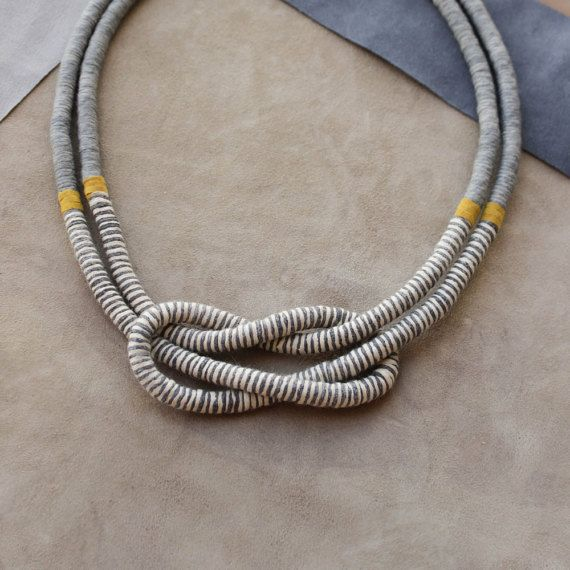Beautiful square knot necklace made of rope hand-wrapped with gummed cotton yarn, part of grey yarn, part of striped grey and vanilla yarn, separated by yellow leather strip. Materials: polyester rope, 100 % cotton yarn, leather strip, metal clasp, leather badge. The necklace is approximately 56 cm / 22 inches in length and one rope is approximately 0.7 cm / 0.27 inches in diameter. If you prefer longer or shorter necklace, please indicate. The item is handmade by me, so it might ...
