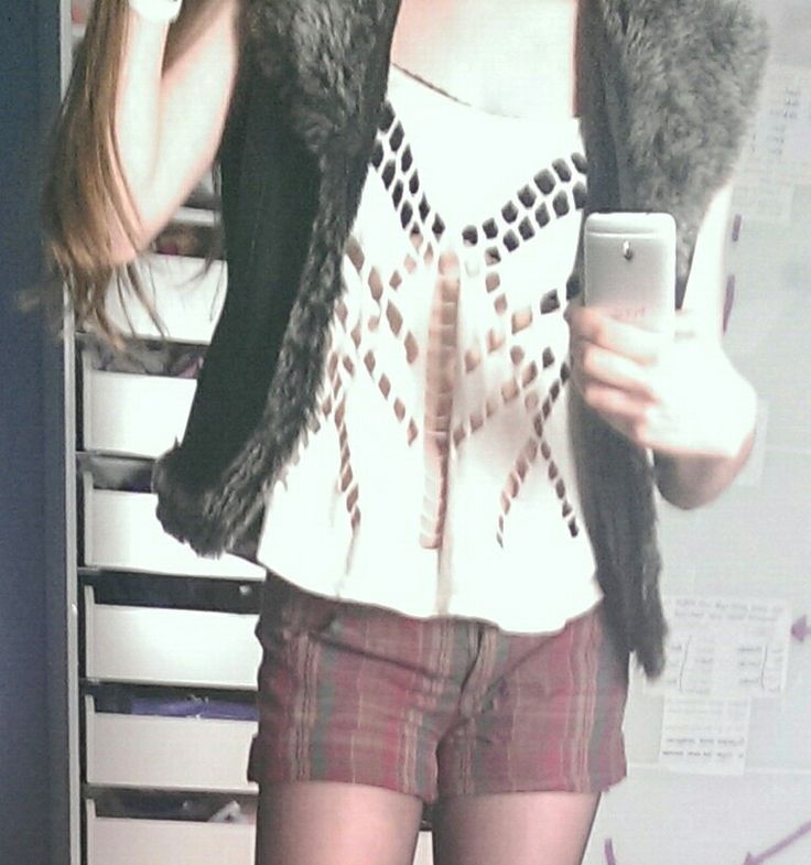 I love this outfit , tartan shorts paired with a riverisland aztec strappy top and furry waistcoat fits in with this season's tartan trend as well as keeping warm for winter
