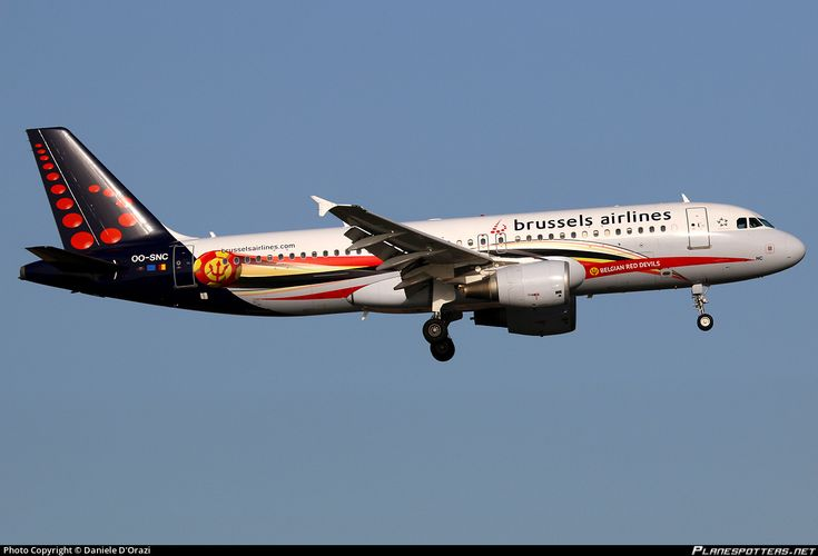 Brussels Airlines Airbus A320-214 OO-SNC aircraft, named ''Margritte'',painted in ''Belgian Red Devils'' special colours Oct 2013-Feb 2016 on the airframe'', on short finals to Italy Rome Fiumicino Leonardo da Vinci International Airport. 09/10/2014.