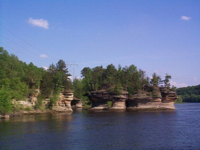 The Dells of the Wisconsin River — also called the Wisconsin Dells (from French dalles, or narrows) — is a 5-mile (8-km) gorge on the Wisconsin River in south-central Wisconsin, USA. It is noted for its scenic beauty, in particular for its unique sandstone rock formations and tributary canyons.