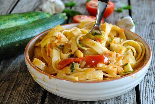 Tagliatelle Pasta With Tomatoes And Zucchini