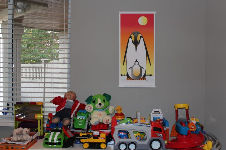 Penguin and Chick with orange background hanging in a kids toy room. Personalization options available on our website
