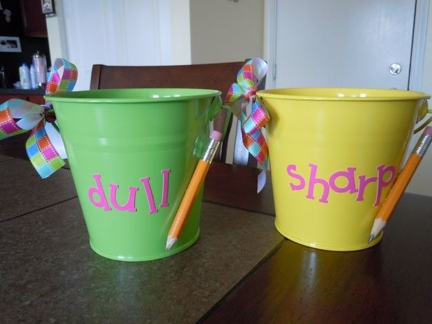 Create a pencil system with decorated buckets. | 36 Clever DIY Ways To Decorate Your Classroom