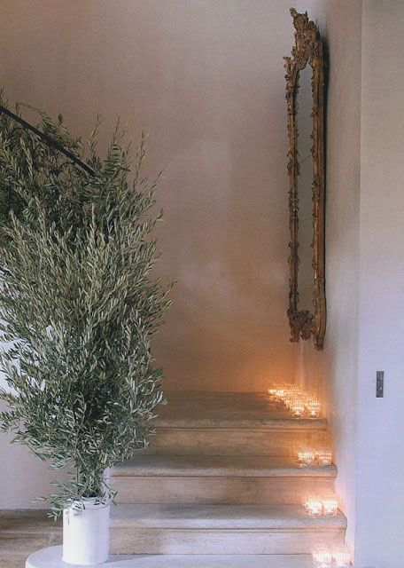 I love the olive tree and the lighting up the stairs...so pretty.