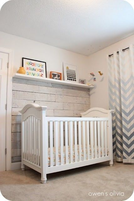 wow that wall is so cool! rustic, white baby room. white pallet boards focal wall.