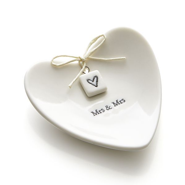 Heart-shaped tray provides wedding rings with a romantic setting when they're not on the happy couple's fingers. Packaged in its own gift box, this keepsake makes a fantastic gift for newlyweds or anniversary-celebrating spouses.