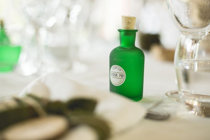 Mini customized green gin bottles are the favours for this rustic wedding. For more inspiration visit www.weddingsite.co.uk