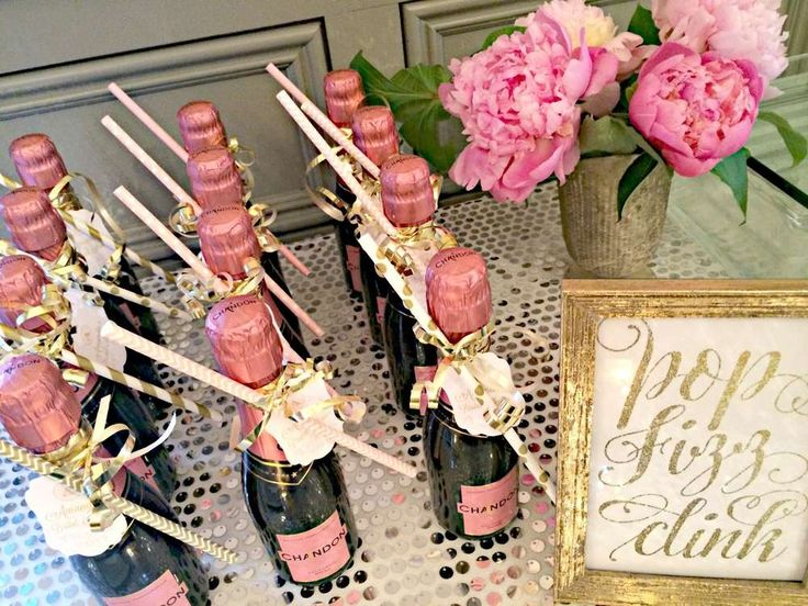 Mini champagne bottle favors from a pink and gold bridal shower party! See more party planning ideas at CatchMyParty.com!