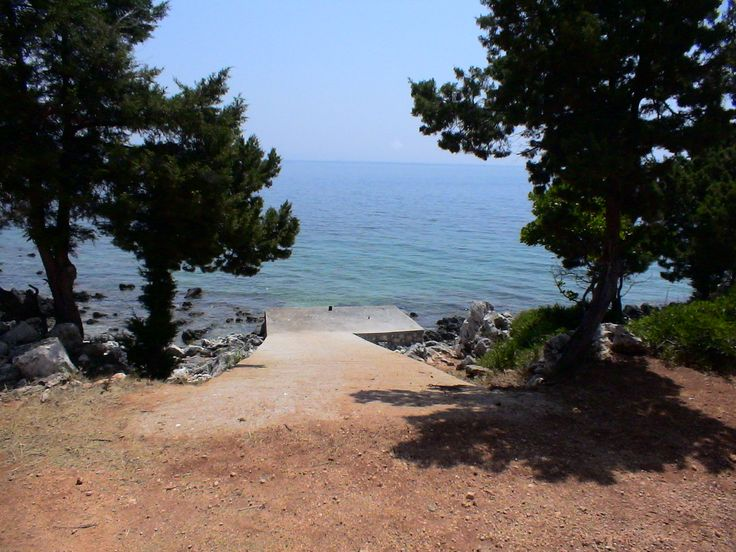 For sale seafront plot of 18.000 sq.m. in the emerald waters of Evgiros with panoramic view, by the real estate agency 'Elinon Gi'.