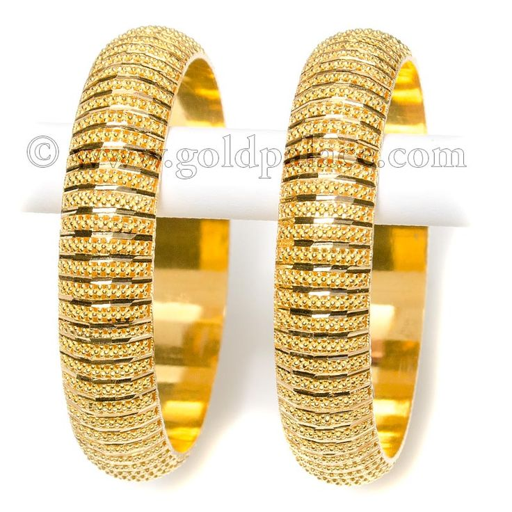 """ Code: 39461 *****In stock, ready to ship*****Current Promotions  Price: $4,820.00  Weight: 86.10 Gms.  Color: Yellow  Gender: Female  age group: Adult  Quantity in Basket: None  22karat gold bangles [ 2 pcs ] inner diameter of the bangle is 2.10/16th inches [ 67.0 mm large size ] single bangle width is 16.0 mm ( 0.64 inch )"""