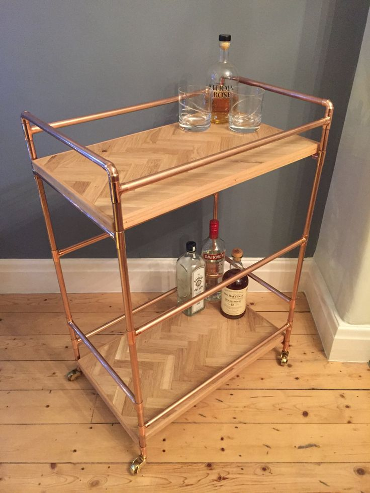 Add a luxurios industrial feel to your living space with this stunning reclaimed wood and copper pipe drinks trolley. Approximate dimensions; Length 57cm (22.5) Width 37cm (14.5) Height 85cm (33.5) The 2 levels of this table are made from reclaimed oak inlayed in a herringbone design. It has been carefully sanded to a nice smooth finish and then varnished to give a hardwearing and durable finish whilst retaining its aged character and texture. All edges are gently rounded off. The tables…