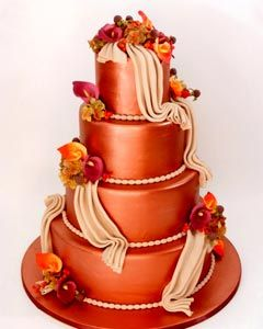 burnt orange wedding cake with flowers
