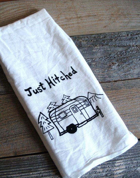 "Just hitched tea towel.    A little vintage camper set up in the woods, with the words ""Just Hitched"" printed above.    Super cute wedding gift for the hard-to-buy-for couple, who has everything!  #RVTravel, #wedding, #gift"