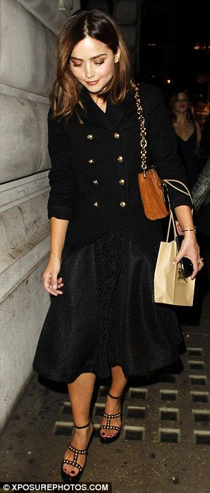 Rather more demure as she left: Jenna completed her looked with a double-breasted military-style jacket and a pair of studded towering platform sandals