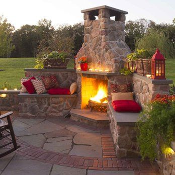 Masonry and stone fireplace with seatwalls and flagstone and brick paving. | Yelp