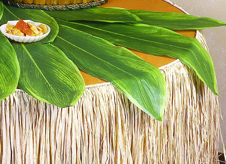 Ti leaves as tablecovers, with a raffia skirt  Look at flower Mart when shopping for flowers