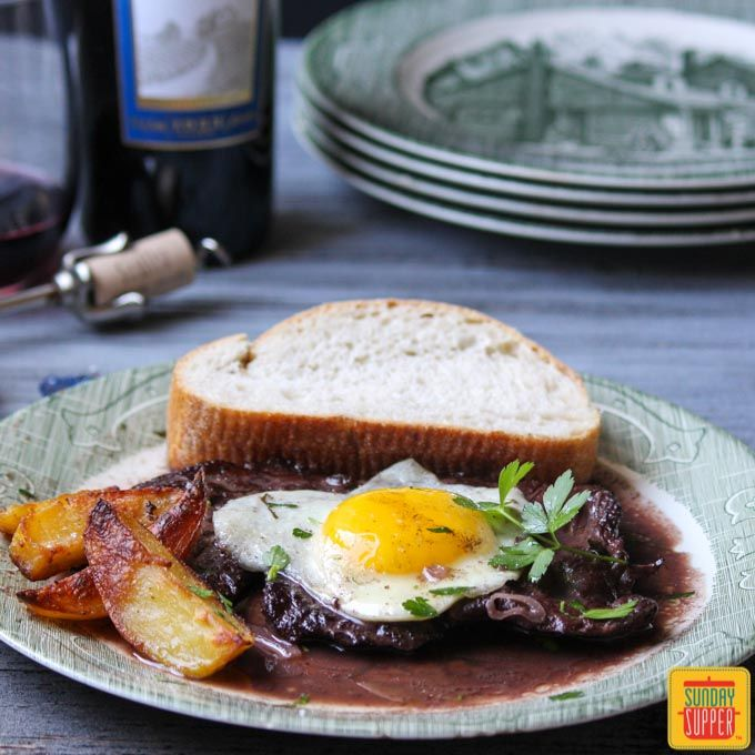 Portuguese Steak and Eggs with an amazing silky wine sauce that is perfect to dip the oven roasted potatoes.