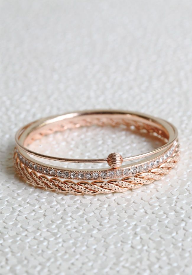 """Romance In The Summer Bangles 26.99 at http://shopruche.com. This set of three beautiful rose gold hued bangles feature glittering rhinestones, braided detail, and a beaded accent.2.75"""" wide"""