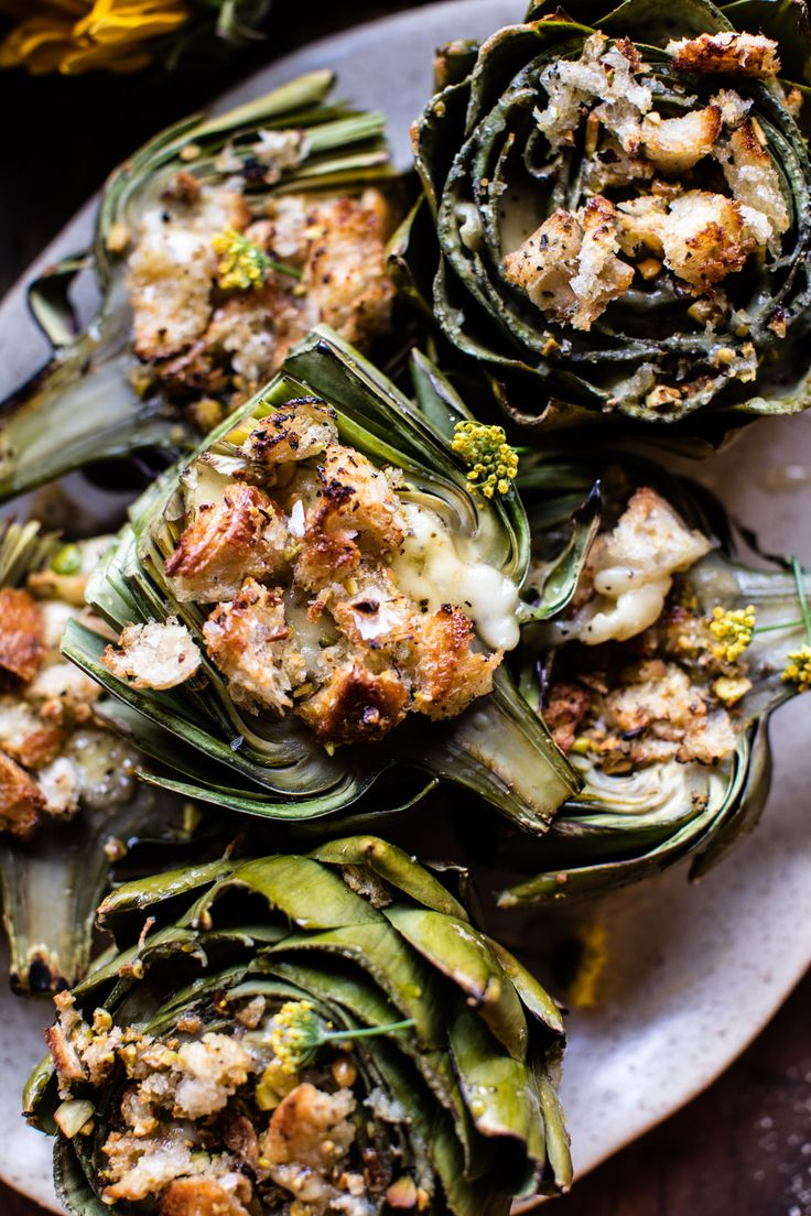 Brie Stuffed Artichokes  by halfbakedharvest: Brie and toasted buttered bread all stuffed into an artichoke, need I say more... delish! #Artichokes #Brie