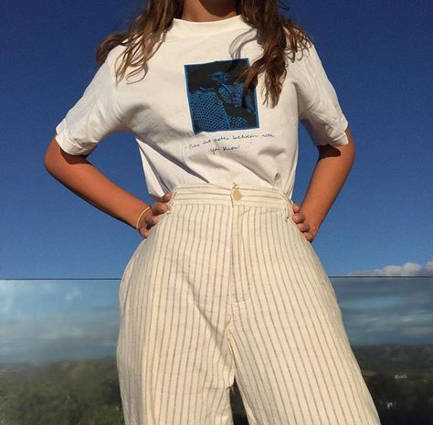 Love these pale yellow stripe trousers.