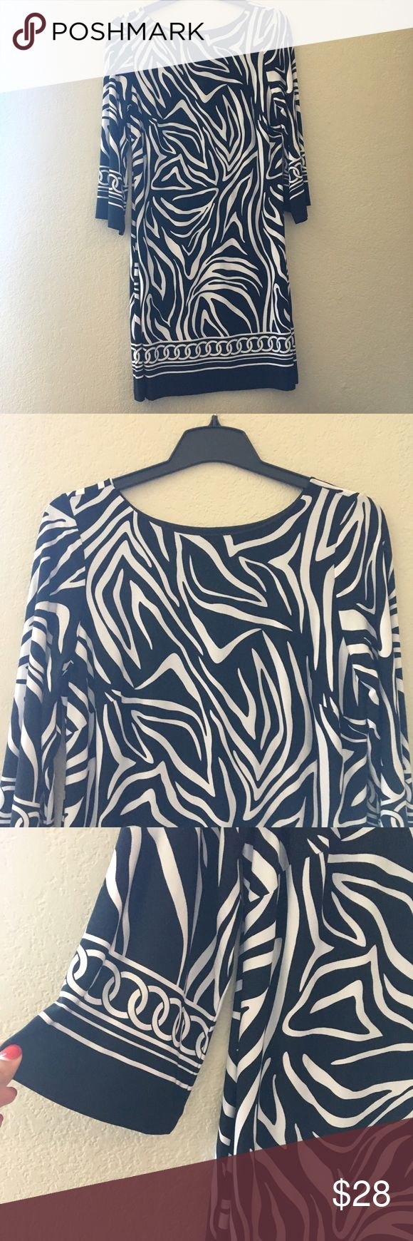 NWOT Black and White Print Jersey Dress New without tags black and white patterned dress. Beautiful, lightweight fabric. Perfect for work and special occasions Dresses Midi