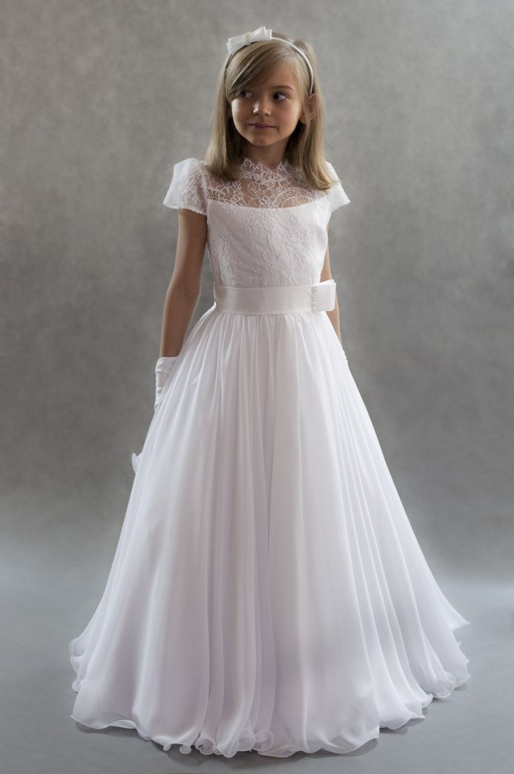 This beautiful full length white communion dress is beautifully decorated with white lace and thick white satin waist ribbon.