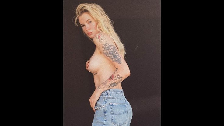 Alec Baldwin's daughter strips topless after online rant