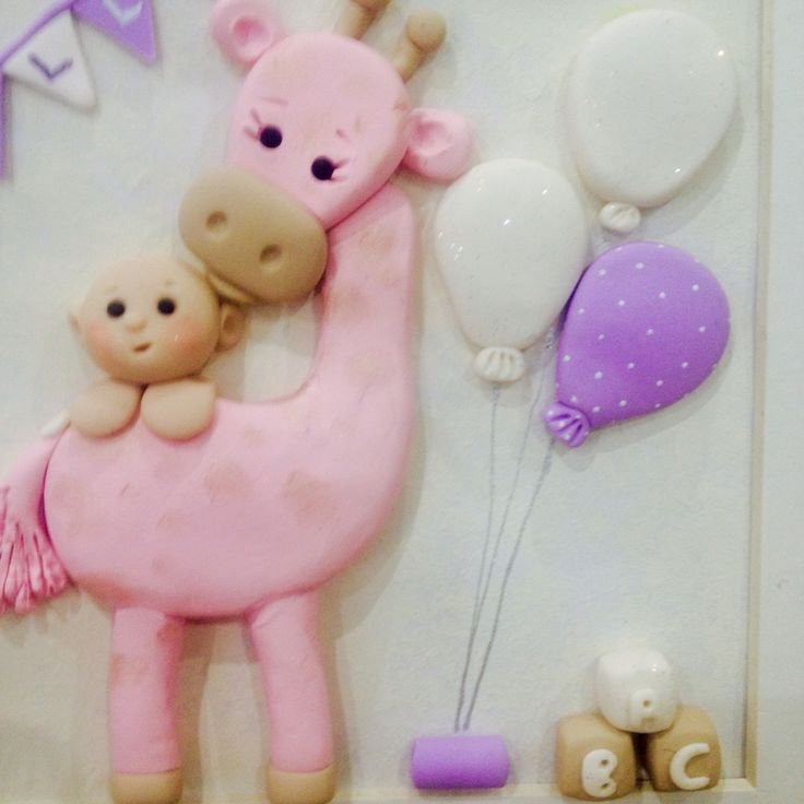 Close up of cute pink giraffe and baby