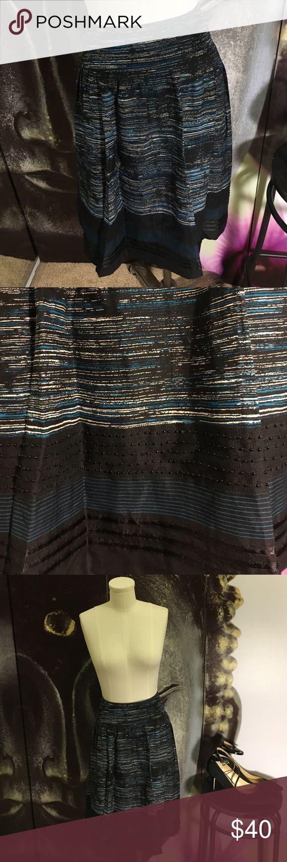 Beautiful Print and Beaded Alfani Petite Skirt Beautiful printed Alfani Petite Skirt. Knee length. Like new. Shell: 81% silk, 19% wool. Size 14P Alfani Skirts