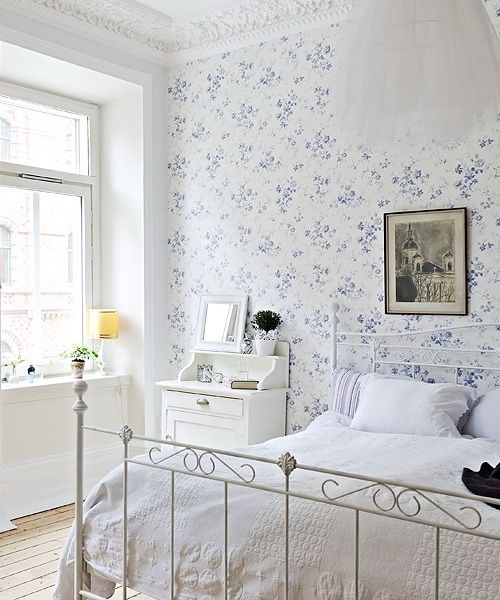 Floral wallpaper, delicate white bed, white bedding. <3