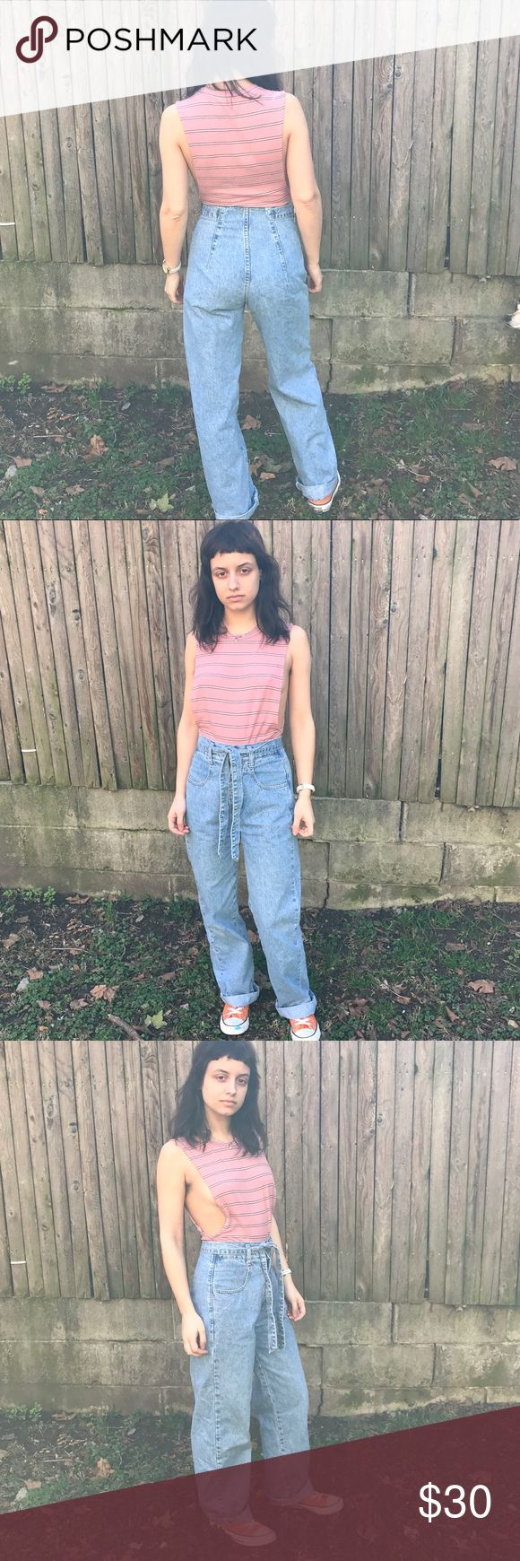 """High waisted Light Denim Vintage Mom Jeans True Vintage Light wash denim mom jeans by County Seat. Bring out your cool 90s chic in these amazing jeans. double button closure with zipper. (one button missing but still closes because other button is there) Matching belt. Size says 3/4.  Model is 5'3"""", 110lbs and they are a perf fit. County Seat Jeans Boyfriend"""