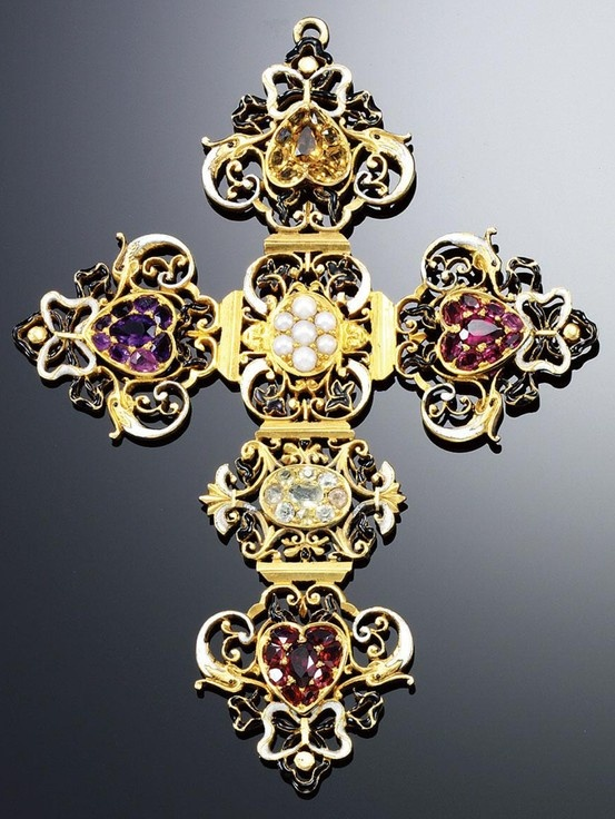 GOLD, ENAMEL AND GEM-SET PENDANT, 1890S. Designed as a Latin cross of black and white enamel open work scroll decoration, applied to the cardinal points with heart-shaped clusters of multi-coloured gemstones including amethyst, citrine and garnet.